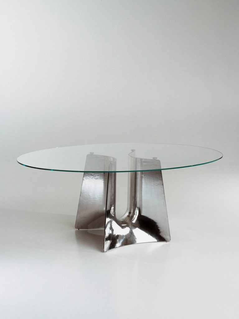 Coffee table with base structure in aluminum sand-casting and tempered glass top.   VAT not included, please inquire for European pricing.
