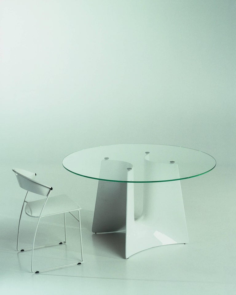 Table with base structure in aluminum sand-casting and tempered glass tops.