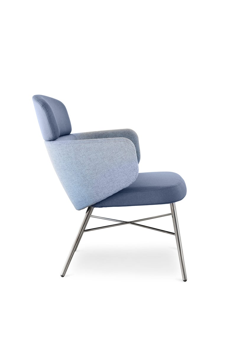 Armchair with structure made of light grey or anthracite grey epoxy powder-coated or black chrome steel tubes. Flexible polyurethane backrest, cold, processed without CFC. The covers are non-removable and they can be made of fabric, leather,