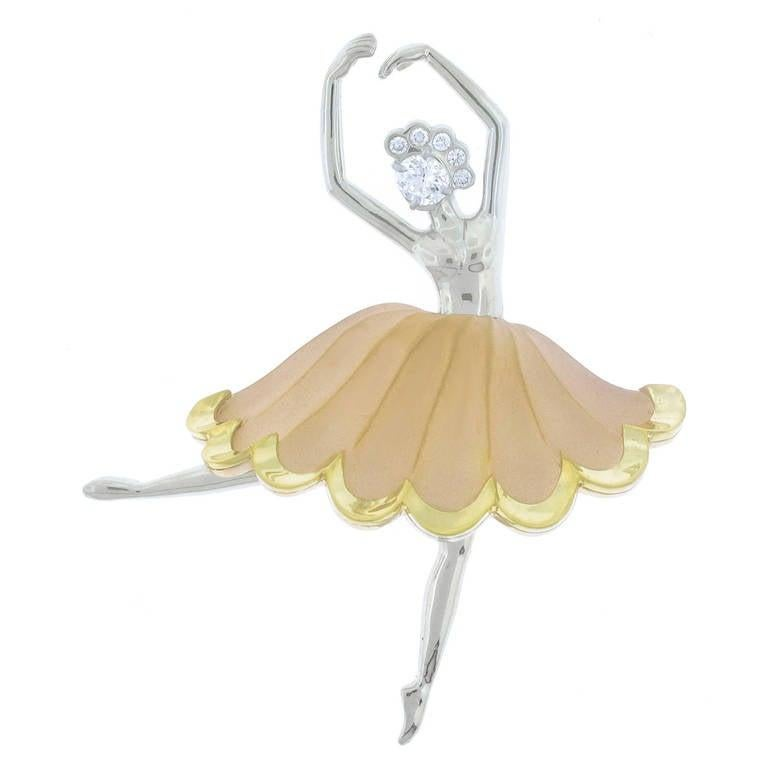 A graceful Ballerina strikes an Arabesque positions.  Painstakingly created from the original 1950s models in 18-karat white, yellow and rose gold by Pampillonia Jewelers. The brooch features a center oval diamond weighing .36 carats and five