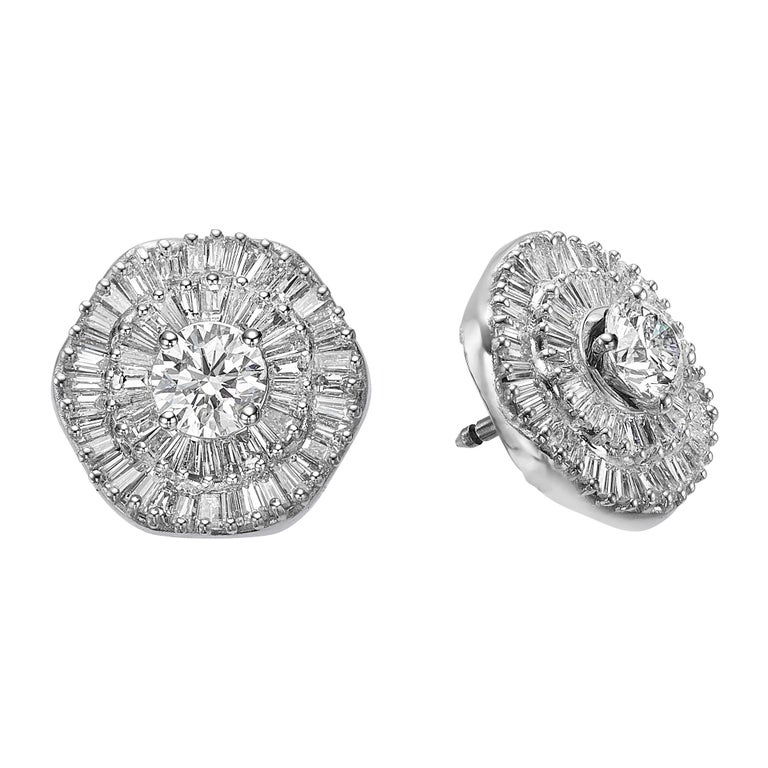 One of a kind Interchangeable earring diamond set which is accompanied with a timeless triple halo diamond ring.  Our hand crafted set is staring GIA certified Interchangeable Double Halo Ballerina style pair of diamond earrings 4.66 Carat TDW & GIA