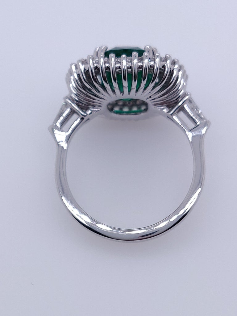Oval Cut Ballerina Style 4.32 Carat Natural Emerald and Diamonds Engagement Ring For Sale