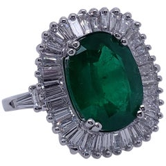 Ballerina Style Oval 4.32 Carat Natural Emerald and Diamonds Engagement Ring