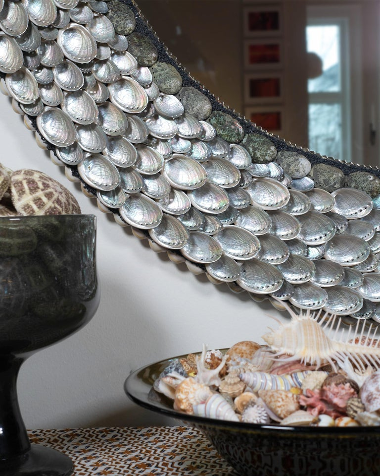 """This is an elegant, shiny shell mirror (ø 102 cm) with a frame that continuously reflects the different lights in a day. """"Ballroom Blitzz"""" is a first in a series of round mirrors where the two Shellman artists take advantage of the pearly inside of"""