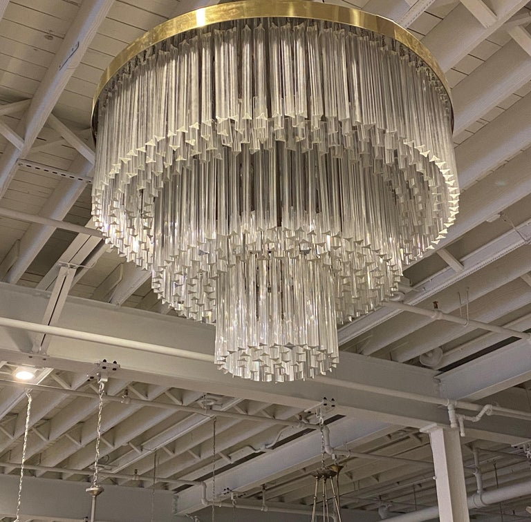 Stunning Mid-Century Modern round flush mount chandelier. Each of the prisms are solid glass, measuring 12 and 4 inches. They hang from hooks on a nickel (silver) frame, as pictured. Has been rewired for American use with 20 medium base sockets.