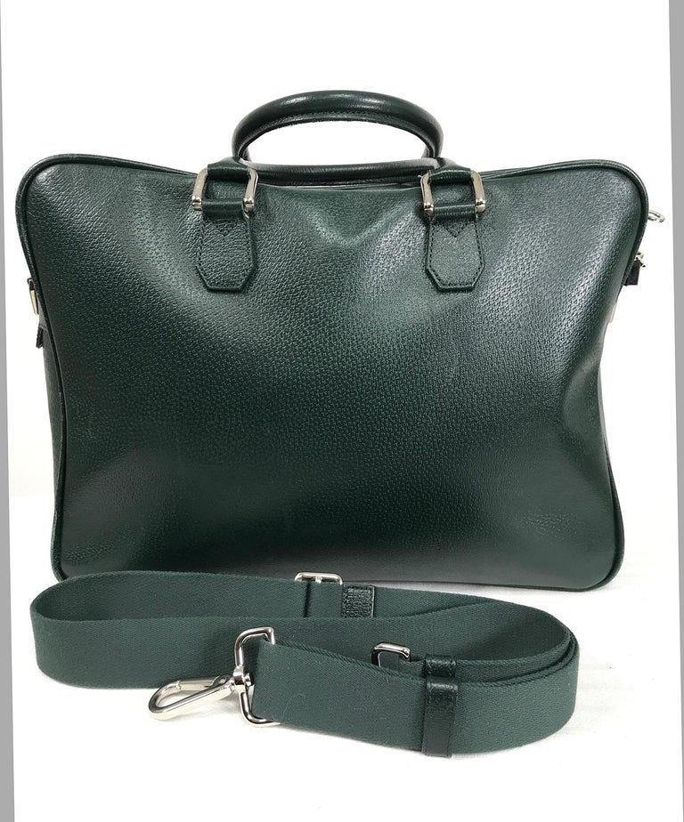 Bally forest green pigskin leather carry on, business bag with removable shoulder strap. Beautiful bag is soft leather, double handles, chrome hardware, logo lock and keys. Zipper outside front compartment. Quilted green lining protects laptop.