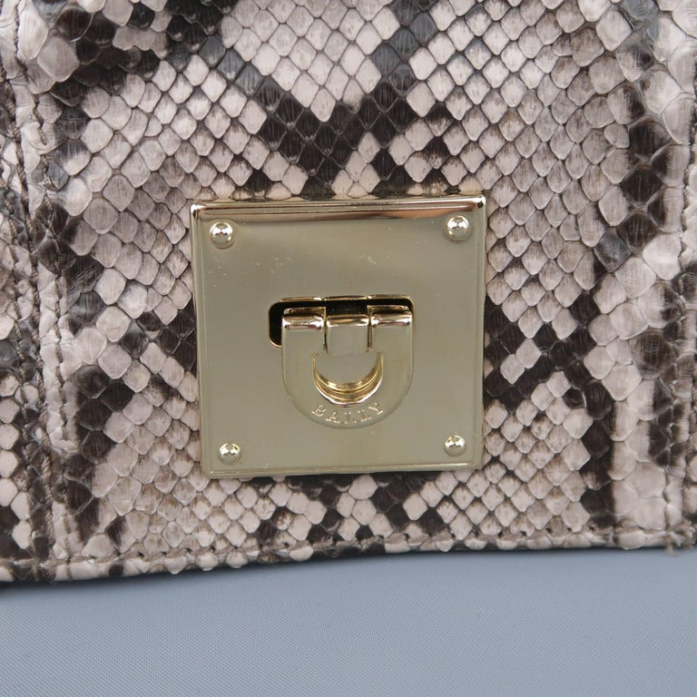 BALLY clutch bag comes in purple tone gray python skin leather with a ruched front, light gold tone hardware, and multi section accordion construction. Made in Italy.   Excellent Pre-Owned Condition.   Measurements:   Length: 10 in. Width: 2