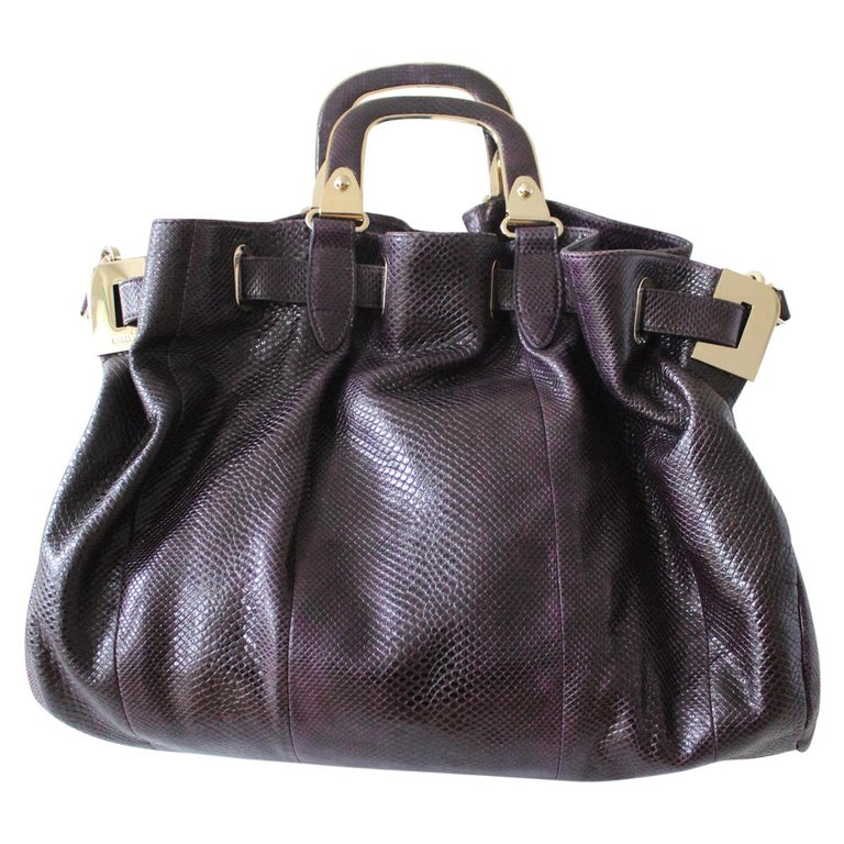 Wonderful bag by Bally Lizard bag Lizard Purple color Two handles can be carried on shoulder too Internal zip pocket and phone holder Metal hardware Grey suede internal Cm 42 x 30 x 10 (16.5 x 11.8 x 3.9 inches) Worldwide express shipping included