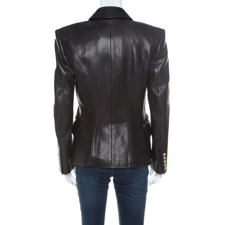 A blazer as finely tailored as this one from Balmain deserves to be in your closet. It has been made from leather and it flaunts a black shade, double-breasted style, and pockets. It'll look perfect with dresses and statement booties.  Includes: The
