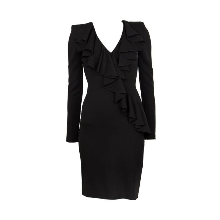 Balmain ruffle dress in black polyester (35%) and viscose (65%) with a v-neck, padded shoulders and long sleeves. Closes with a gold zipper on the back. Unlined. Has been worn and is in excellent condition.  Tag Size 36 Size XS Shoulder Width 72cm