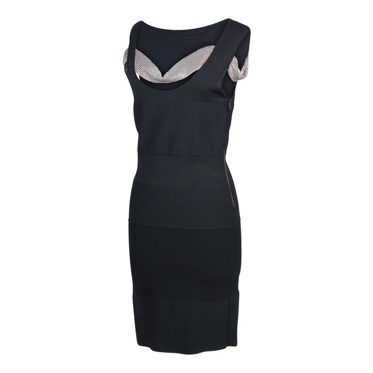 Guaranteed authentic Balmain sleeveless black knit dress with a low scoop neck. Varying bands of knit create a unique bandage effect.  Some of the bands are semi sheer.  2