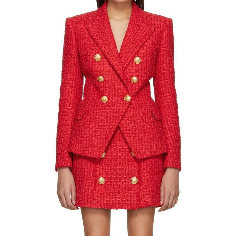 Long sleeve woven cotton and acrylic-blend tweed blazer in red. Peaked lapel collar. Double-breasted button closure. Patch pocket at bust. Flap pockets at waist. Five-button surgeon's cuffs. Viscose-blend twill lining in black. Logo-engraved