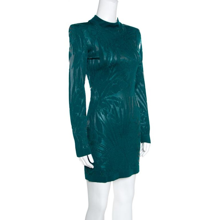 On days you want to stand out and make an impression, this mini dress from Balmain is just perfect! The green dress is made of a viscose blend and features a floral jacquard knit pattern all over it. It flaunts a flattering silhouette and comes with