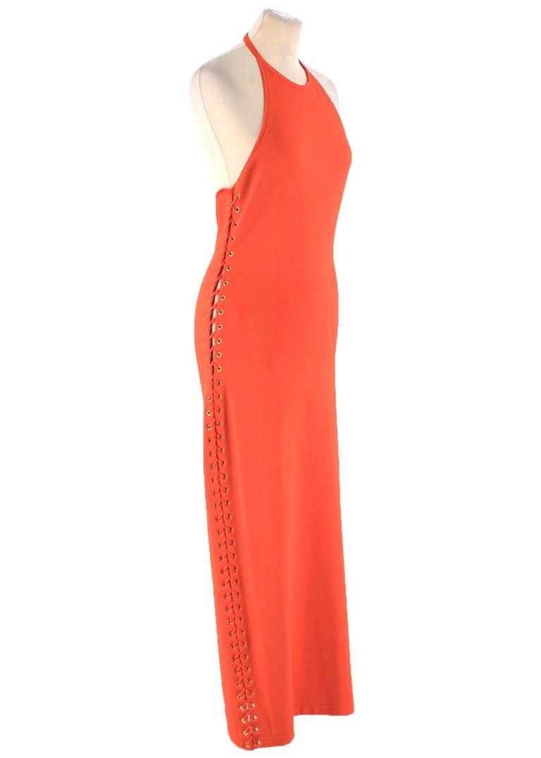 Balmain orange lace-up halterneck midi dress  - Orange, heavyweight knit  - Close fitting halterneck, double push-stud fastening  - Open back  - Laced orange side feature, gold-tone metal eyelets  - Centre-back chunky gold-tone metal zip fastening