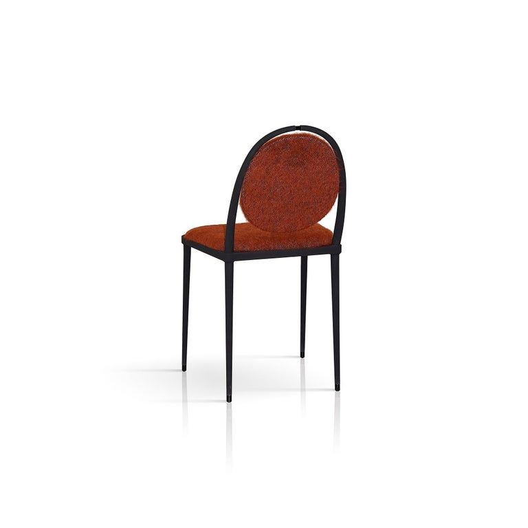 Part of the Balzaretti series, this chair reflects the traditional values of Italian craftsmanship reinterpreted in a light and modern design of great visual harmony. Stunning in its simplicity, the matte black metal frame features slender legs and