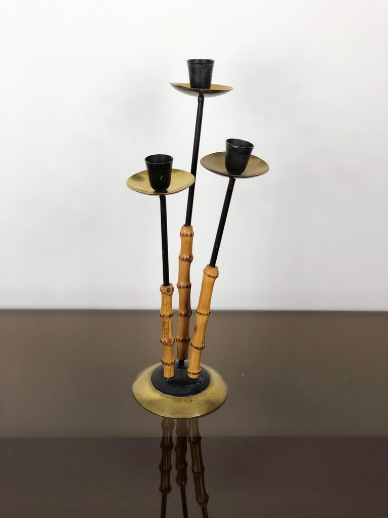 Candleholder in brass, metal and bamboo with three arms, Italy, circa 1970.