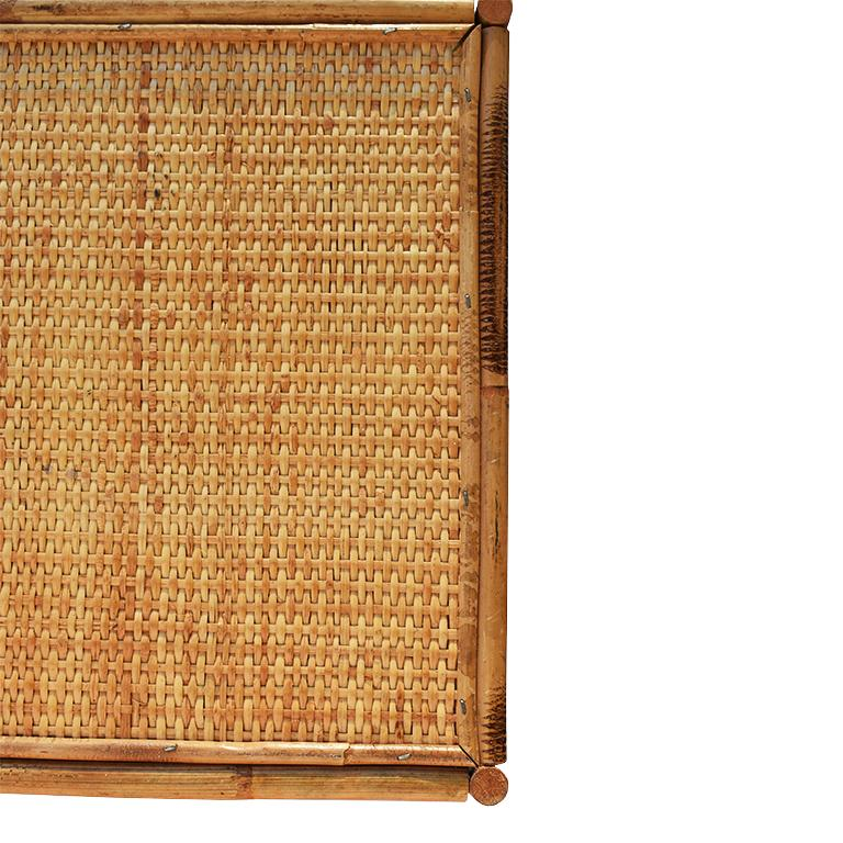 Scorched Bamboo or what is also commonly referred to as tortoise or tiger bamboo, breakfast tray, lap or bed tray. This lovely 1930s piece is composed of rattan, bamboo, and cane. The top portion where food is served is covered in a woven cane