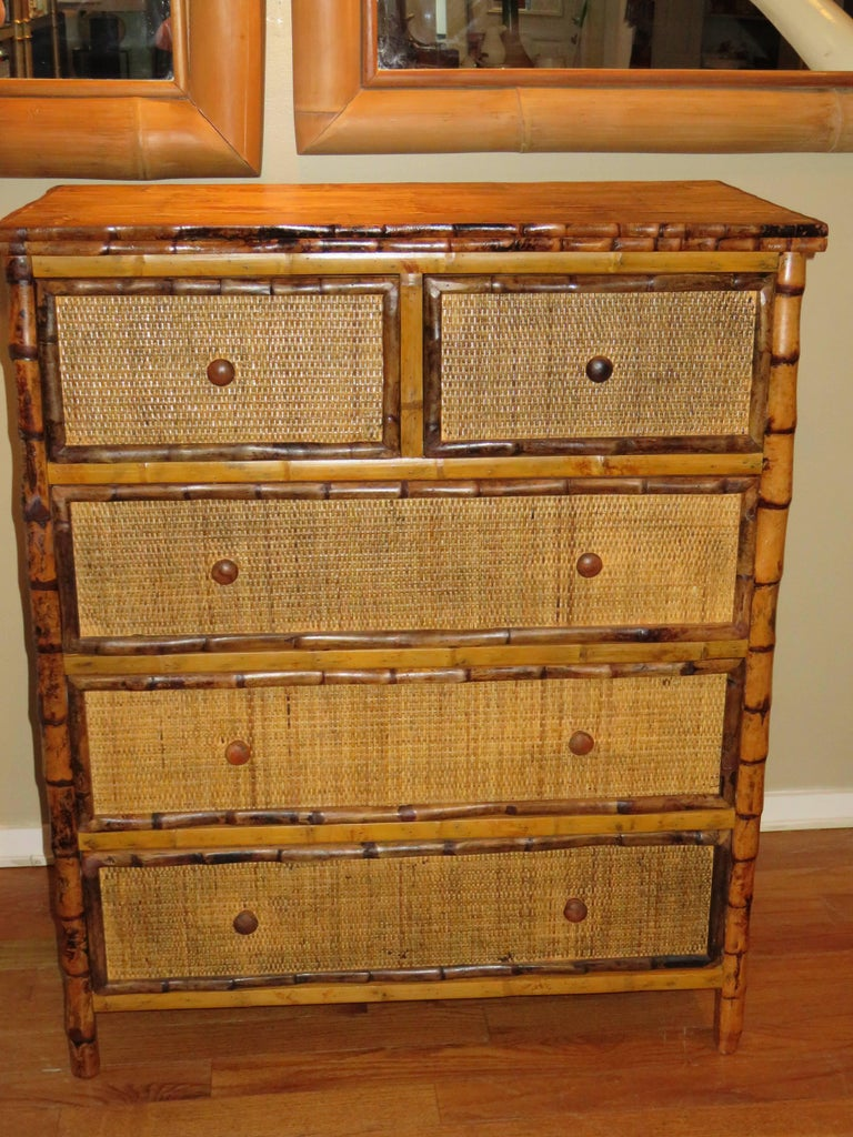 A Bermudan tall bamboo and cane five-drawer dresser. All drawers pull out on metal rails for easy use. Handcrafted in Bermuda in the British Colonial style. Two small top drawers and three larger drawers, great storage.