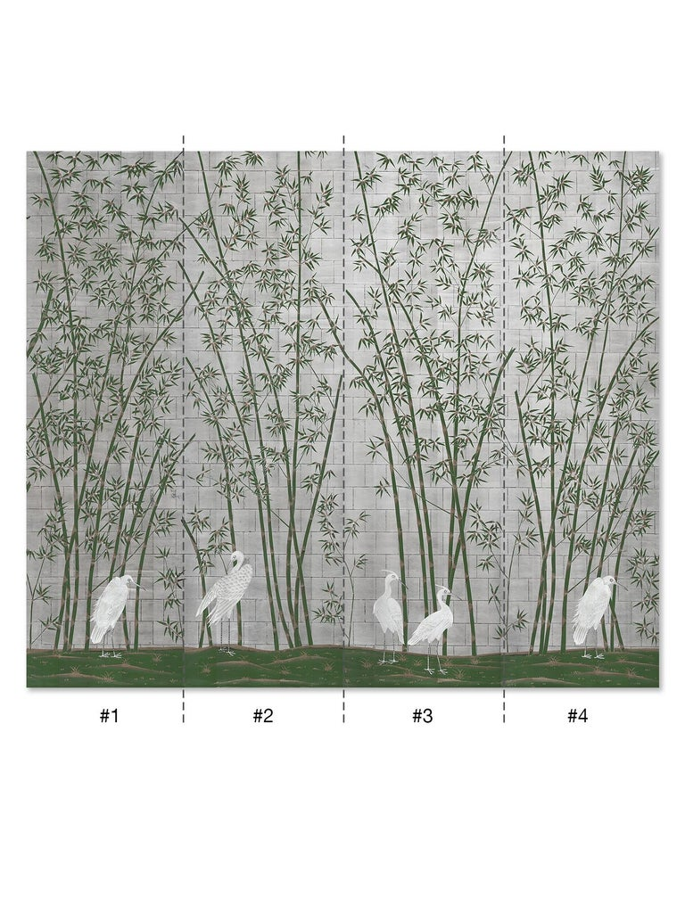 Bamboo and Cranes is an exotic mural of bamboo trees with a group of majestic white cranes below. This mural is hand painted on silver metal leaf paper. The bamboo trees are delicately wrought in a deep green with white lines and gold highlights.