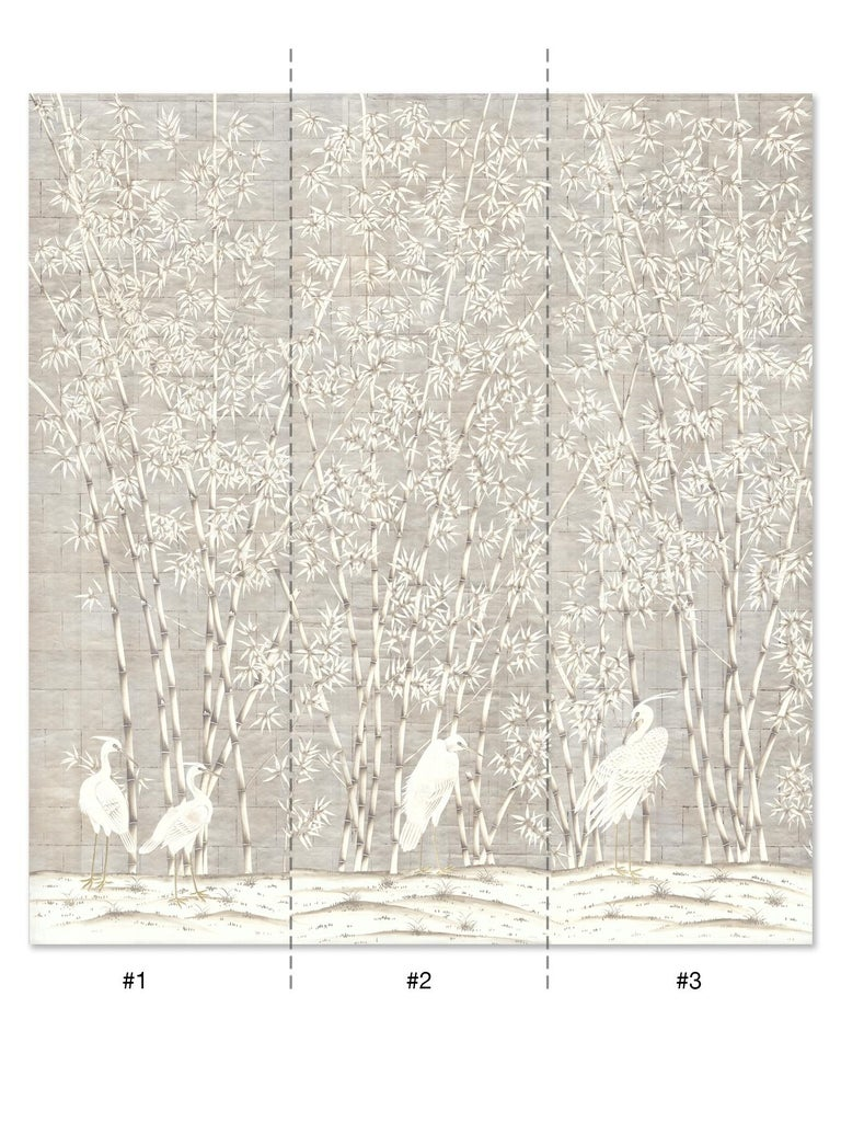 Bamboo and cranes is an exotic mural of bamboo trees with a group of majestic white cranes below. This mural is hand painted on silver metal leaf paper. The bamboo trees are delicately wrought in a warm antique white with grey highlights. The full