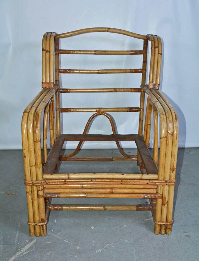 Vintage bamboo lounging armchair with beautiful lines and clean wicker or rattan like design.
