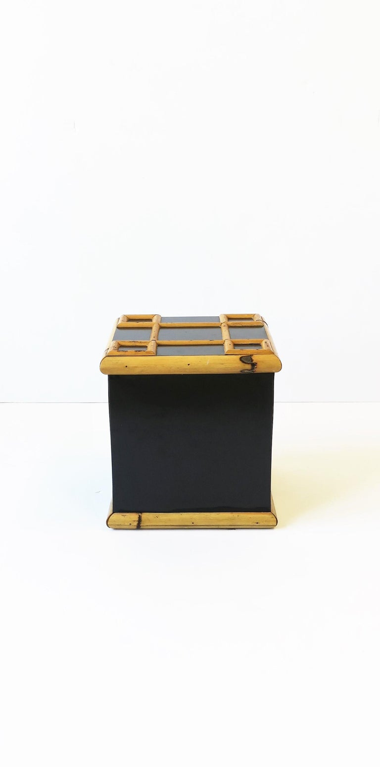 A great vintage bamboo and black laminate ice bucket, circa 1960s. Piece is square with a lattice bamboo design on top/lid and a bamboo edged base. Piece measures: 8.75