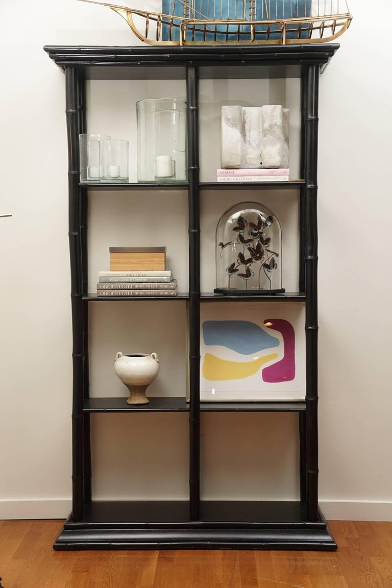 graceful, custom-made bamboo bookcase, with four shelves and eight sections for displaying all your wonderful treasures! (objects not included ).