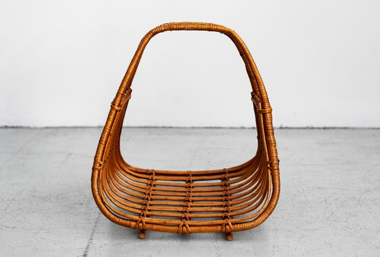 Sculptural French bamboo and wicker magazine holder.