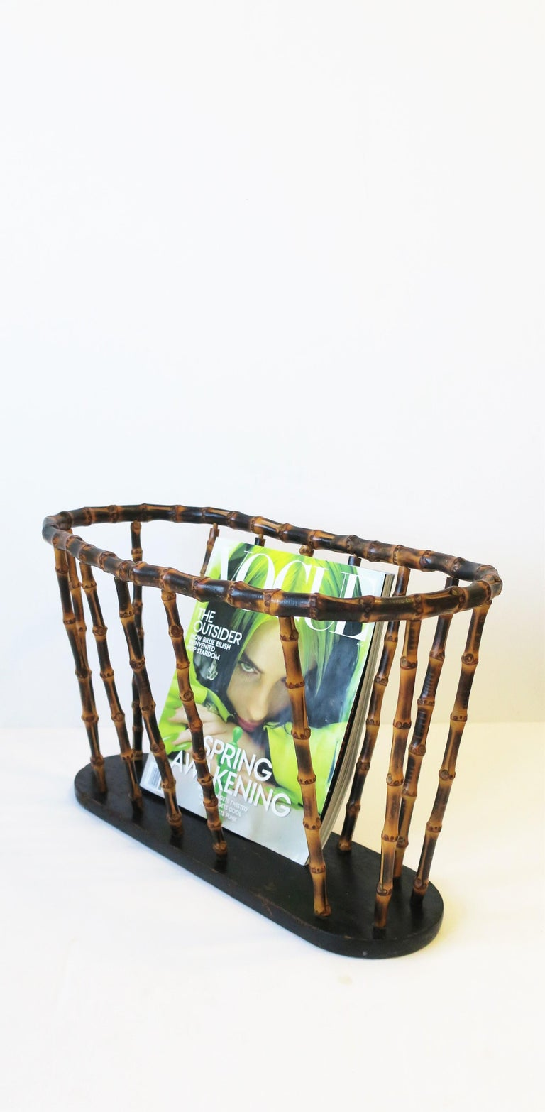 An oval or oblong bamboo magazine, book, or newspaper holder 'basket', in the style of Gucci, circa 20th century.   Piece measures: 10