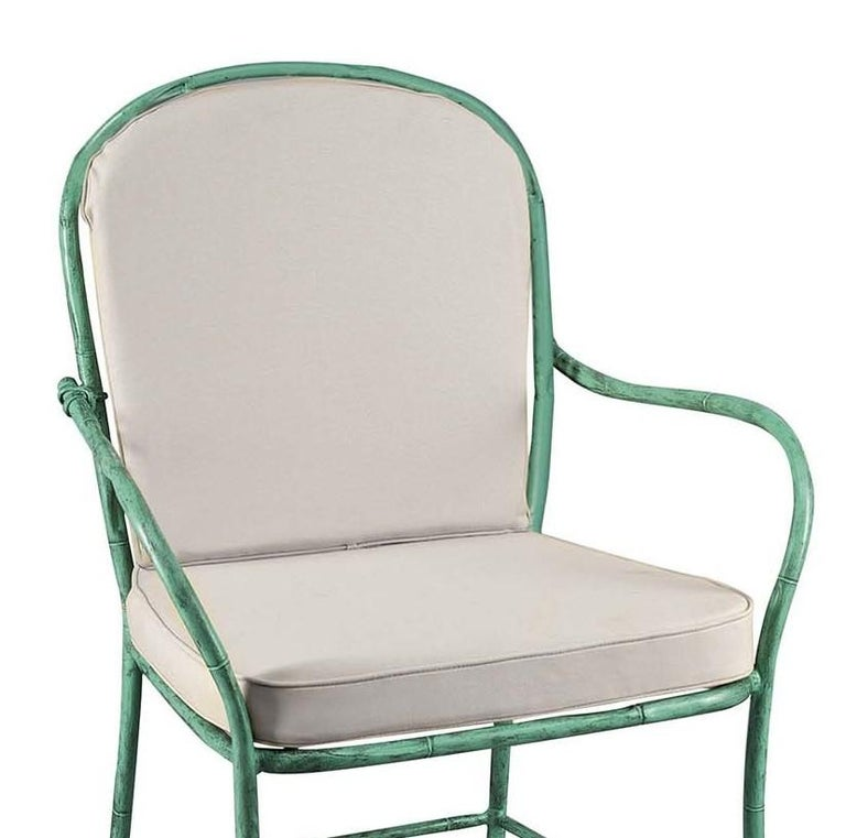 This elegant outdoor chair is part of the Bamboo Collection and will be a striking addition to a modern or classic veranda, poolside, or terrace. Its thin structure is crafted of forged iron shaped to reproduced the texture of bamboo sticks and