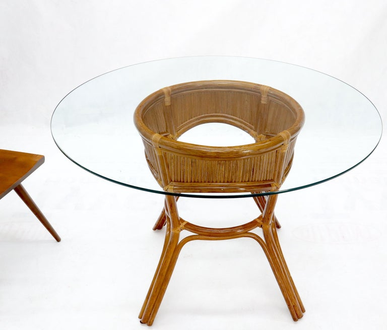 Bamboo rattan base round glass top dining dinette table.