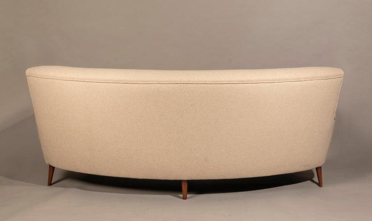 Curved sofa, Denmark 1950s, oak legs, reupholstered in Casamance wool.