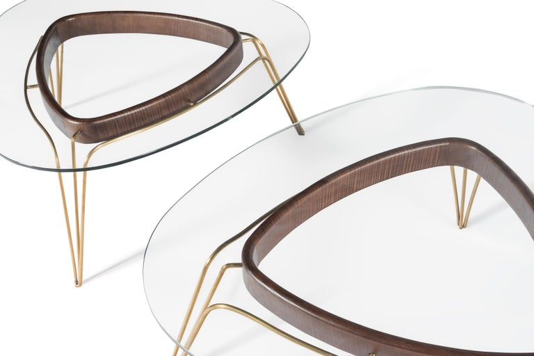 These gems for the sitting room cleverly combine, walnut, glass and a brass frame. Their two heights mean than when used together, they can form a cluster thatcompliments the arrangement of sofas and armchairs.