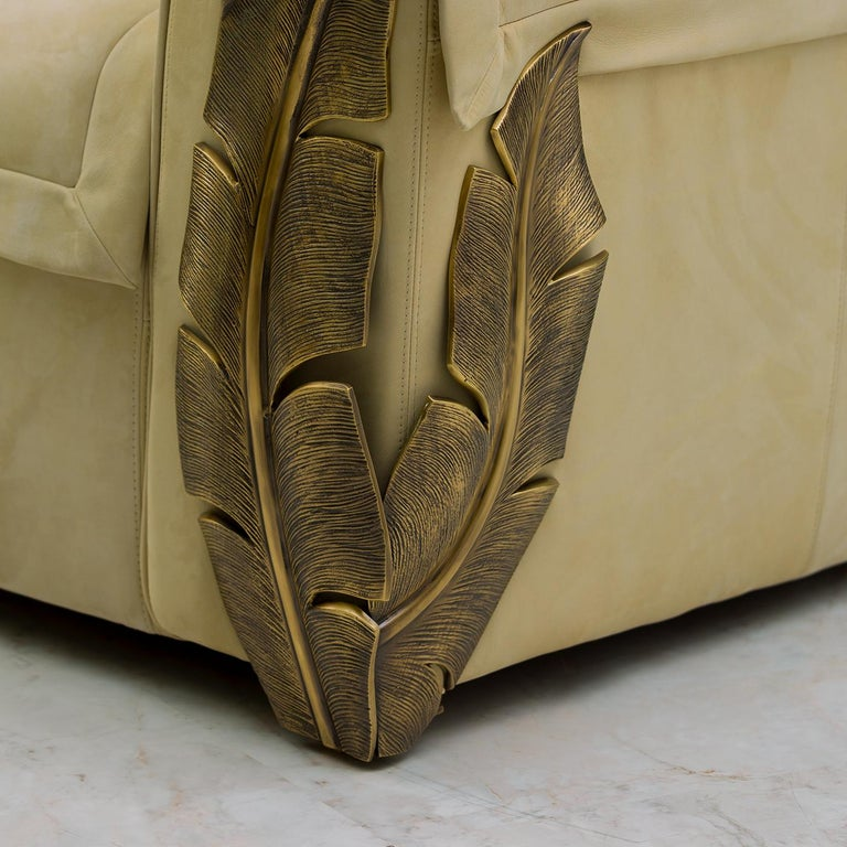 This stunning sofa is entirely crafted by hand and custom made to meet any designing need. Its structure in solid wood is covered with five different layers of
