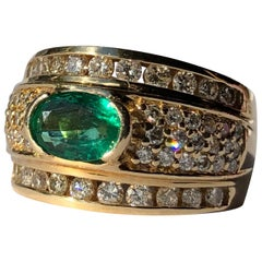 Band Ring With Oval 1ct Emerald 1.50ct Round Brilliant Cut Diamonds 18k Gold