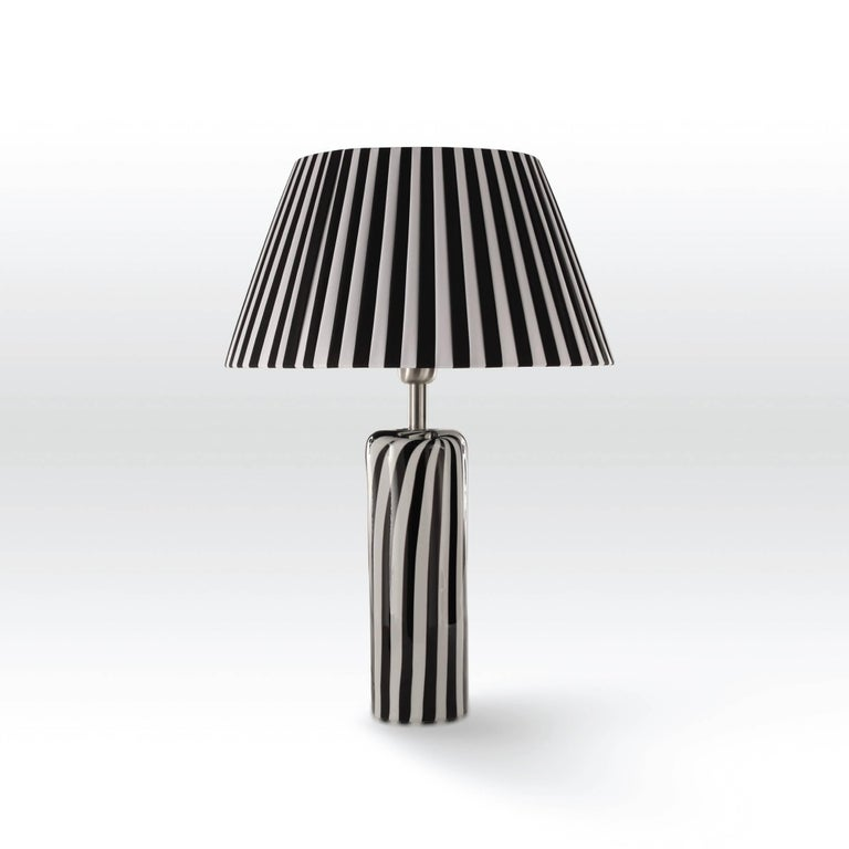 Italian modern table lamp shown in white and black striped Murano glass base and white and black striped lampshade. One light / E26 or E27 type / max 60W Measures: Diameter 15.5 inches, height 22 inches Order only / Made in Italy Please inquire for