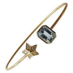 Bangle Bracelet in 18 Karat Yellow Gold with a Diamond Star and an Aquamarine
