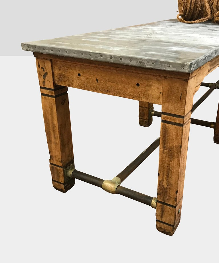 Oak frame with zinc top and brass detailing.
