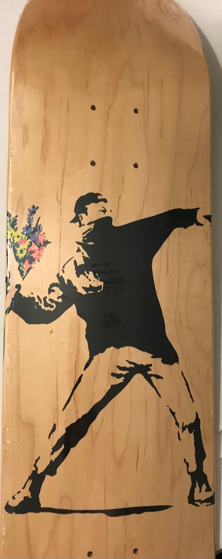Banksy Flower Thrower Skate Deck Colored Edition, 2016 Screenprint in colors on skate deck 32 × 8 in 81.3 × 20.3 cm Edition of 1000