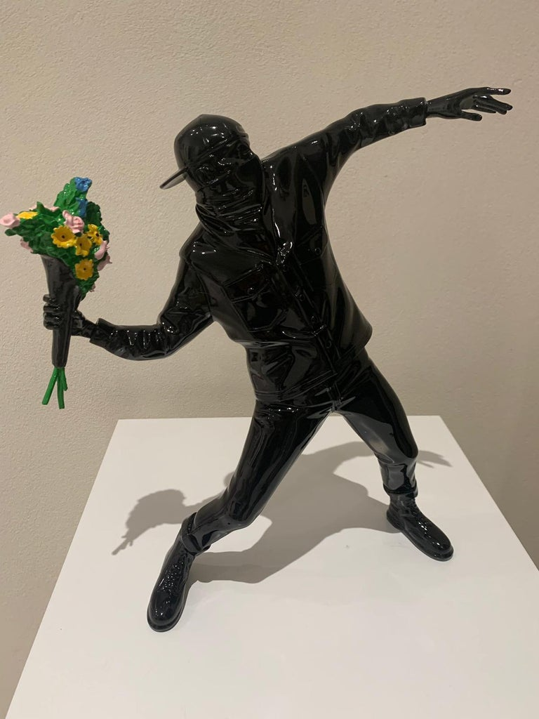 Banksy X Brandalism Flower Bomber, 2016 Polystone 16 x 14-1/4 inches (40.6 x 36.2 cm) Stamped to the underside of the feet Produced by Medicom Toy and SYNC, Japan   Accompanied by Brandalism, a collective known for deflecting advertisements, Medicom