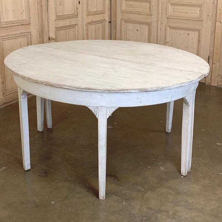 Early 19th century Swedish Gustavian period painted banquet table is a marvel of understated elegance, and functional architecture! Subtle whitewashed finish is ideal for today's casual decors. Broad, rounded ends allow three to sit at each end,