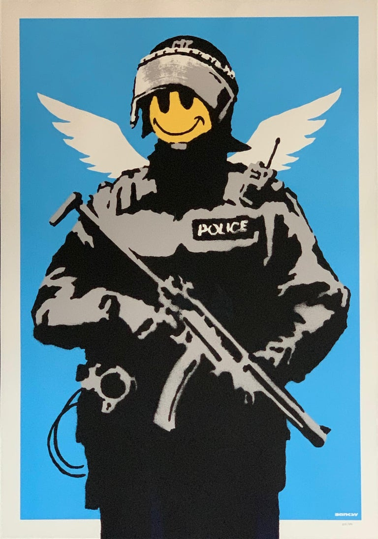 Flying Copper Banksy 2003 unsigned  Flying Copper is an early iconic image from Banksy. The work shows a heavily armed British police officer with little angel wings and a yellow smiley face. Flying Copper was visible under the form of giant