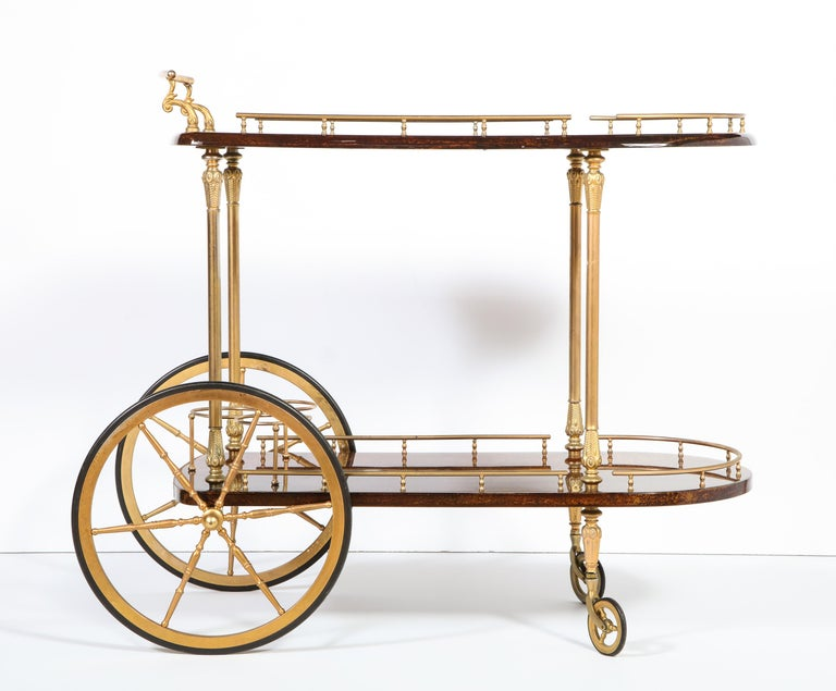 Decorative Aldo Tura lacquered goatskin parchment two level bar cart trolley with brass detailing. Italy, circa 1950.