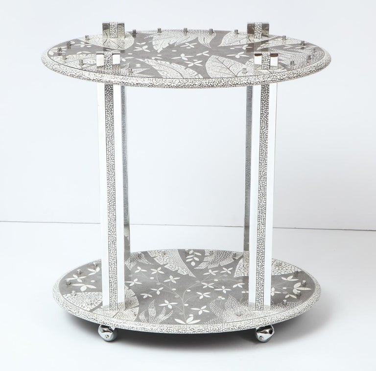 Decorative bar cart from South Africa. The beautiful pattern is an inlay of ostrich eggs, in cement with details of aluminum.