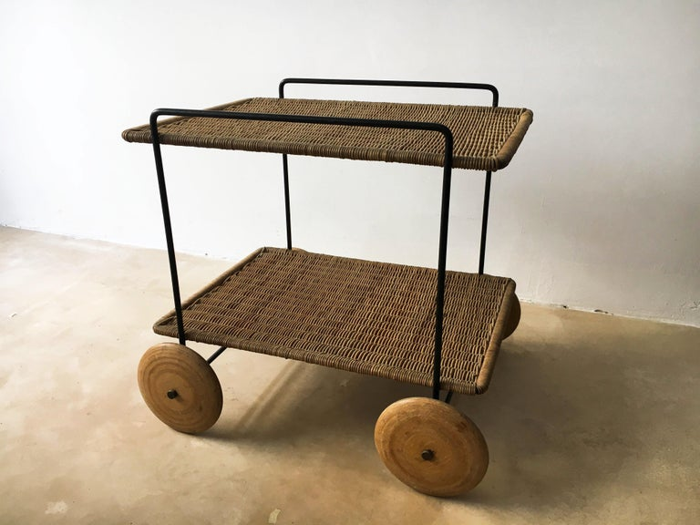 Carl Auböck II Vintage Bar Cart Serving Trolley, Iron & Wicker, Austria 1950s. Black painted metal frame, wicker shelves and plywood wheels - all is was intended to be. One of the finest pieces to come from the Werkstätte Auböck and the perfect