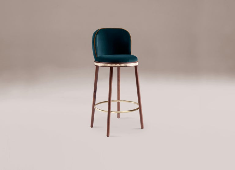 """Bar chair - Alma by Dooq  Dimensions: W 46 cm 18"""" D 51 cm 20"""" H 100 cm 39"""" seat height: 75 cm 30"""" Materials: upholstery fabric or leather; structure solid wood feet lacquered MDF or solid wood rattan natural rattan. COM with natural walnut or"""