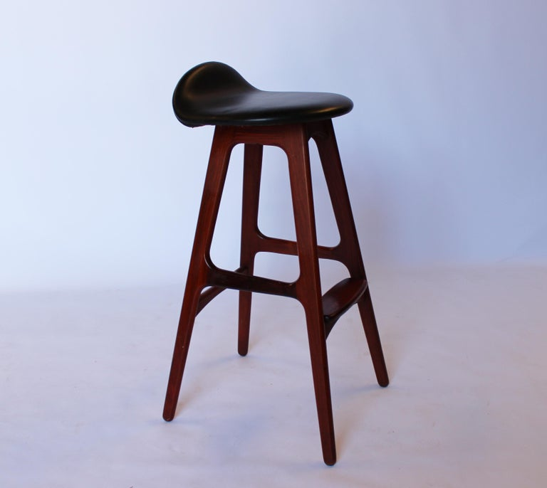 Bar stool, model OD61, designed by Erik Buch and manufactured by Odense furniture factory. The stool are of rosewood and black leather seat. The stool is in great vintage condition.