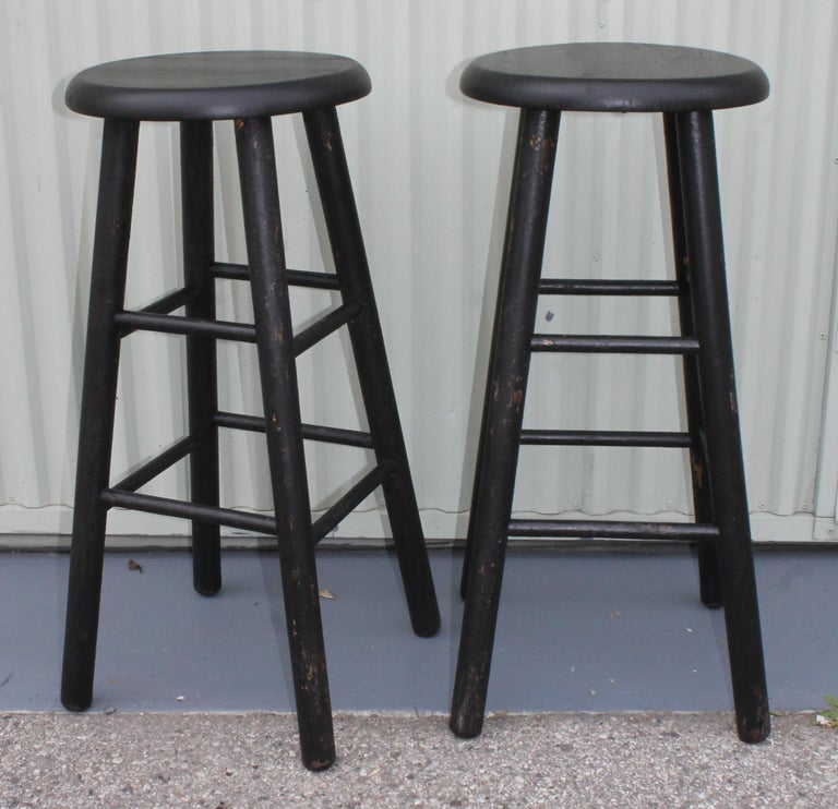 Pair of midcentury plank seat bar stools. Beautiful black painted surface. In great and sturdy condition.