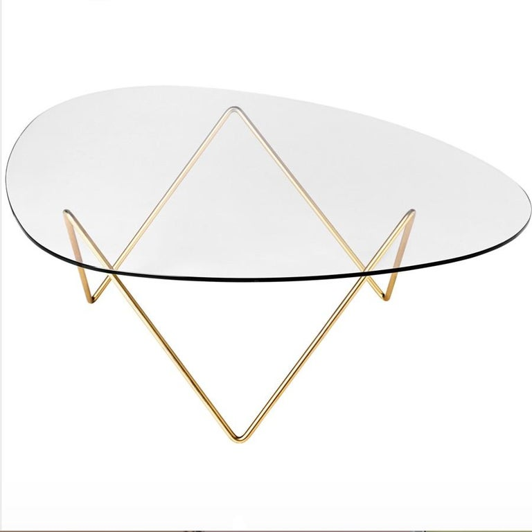 Barba Corsini Pedrera coffee table in brass for Gubi. The Pedrera coffee table was designed in 1955 by Barba Corsini for the loft space at La Pedrera, the famous landmark in Barcelona. Executed in glass with a brass-plated metal base, the table fits