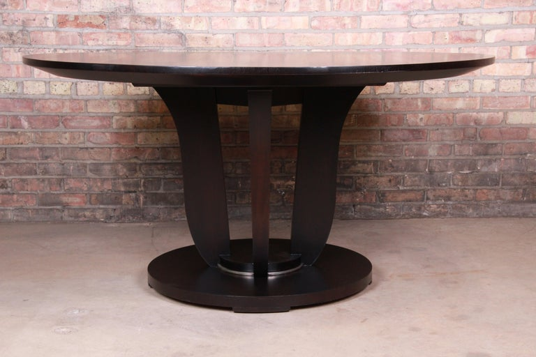 An exceptional modern dark mahogany dining or center table